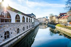 Ljubljanica river with old central market and Triple bridge, Lju. Bljana. View from Butchers` bridge at Plecnik`s Covered Market and Tripple bridge by famous Stock Images
