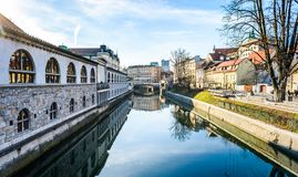 Ljubljanica river with old central market and Triple bridge, Lju. Bljana. View from Butchers` bridge at Plecnik`s Covered Market and Tripple bridge by famous Royalty Free Stock Photo