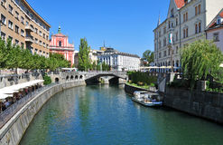 Ljubljanica river and Triple bridges in background, Ljubljana, Sl Stock Photos
