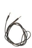 Ljudsignal stålar för gitarr med svart kabel som isoleras på vit bakgrund Royaltyfri Foto