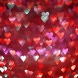 Ljus abstrakt bakgrund för röda och rosa hjärtor Fotografering för Bildbyråer