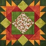 Ljus apelsin-gräsplan geometriskt patchworkkvarter från stycken av fab royaltyfri illustrationer