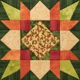 Ljus apelsin-gräsplan geometriskt patchworkkvarter från stycken av fab arkivfoton