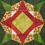 Ljus apelsin-gräsplan geometriskt patchworkkvarter från stycken av tyger royaltyfri bild