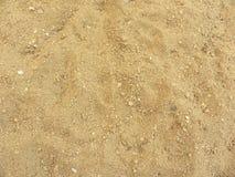 Ljus beige texturerad bakgrund för färg sand Arkivfoto
