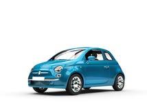 Ljus blå liten ekonomibil Arkivbilder