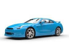 Ljus blå sportbil på vit bakgrund Fotografering för Bildbyråer