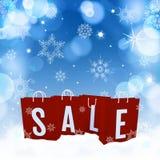 Ljus - blå suddighetsbakgrund för jul med snöflingor och sal Royaltyfria Bilder