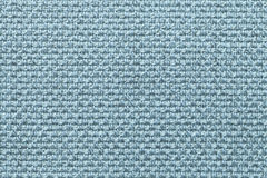 Ljus - blå textilbakgrund med den rutiga modellen, closeup Struktur av tygmakroen fotografering för bildbyråer