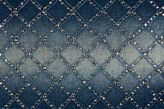 Ljus-blått denim med guling och försilvrar rhinestones Arkivbilder