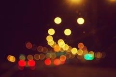 Ljus bokeh för natt från den stads- gatan Royaltyfria Foton