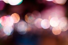 Ljus bokeh som är färgrik på natten Royaltyfria Foton