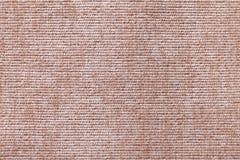 Ljus - brun bakgrund från mjukt textilmaterial Tyg med naturlig textur royaltyfria bilder