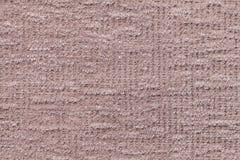 Ljus - brun fluffig bakgrund av den mjuka ulliga torkduken Textur av den flotta päls- textilen, closeup royaltyfri foto