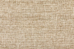 Ljus - brun textilbakgrund Arkivfoton