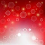 Ljus bubblabokeh på röd bakgrund Royaltyfri Foto