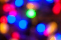 Ljus färgrik bokehbakgrund för Xmas Arkivbilder