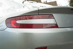Ljus för Aston Martin Vantage English Grand Tourer sportbilbaksida Arkivbilder