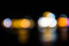 Ljus för Bokeh bakgrund filtrerade färgnatt Fotografering för Bildbyråer