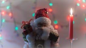 Ljus för Santa Claus Christmas gåvastearinljus Arkivfoto