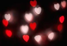 Ljus fantasi för abstrakt röd hjärtabokehvision på svart bakgrundsdesign i röd ram med röd hjärta, upplyst ljus effekt Arkivbild