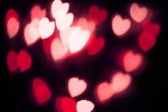 Ljus fantasi för abstrakt röd hjärtabokehvision på svart bakgrundsdesign i röd ram med röd hjärta, upplyst ljus effekt Royaltyfri Bild