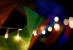 Ljus girland på natten med asiatiska flaggor Royaltyfria Foton