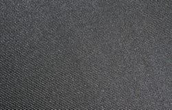 Ljus - grå tygtextur Texturen av tyget som göras virkning Royaltyfri Fotografi