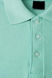 Ljus - grön polot-skjorta Fotografering för Bildbyråer