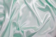 Ljus - grön siden- torkduk av krabb abstrakt bakgrund Royaltyfri Bild