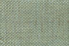 Ljus - grön textilbakgrund med den rutiga modellen, closeup Struktur av tygmakroen Royaltyfria Bilder