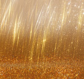 Ljus guld- bokehljus och textur Defocused abstrakt bakgrund Arkivfoto