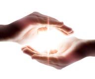 Ljus i händerna Arkivbilder
