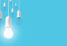 Ljus kula för skillnad på blå bakgrund Begrepp av nya idéer Royaltyfri Fotografi