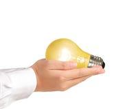 Ljus kula, idérik idé för ljus kula i handen Royaltyfri Fotografi