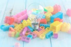Ljus kula med färgrika kvarterleksaker jpg Fotografering för Bildbyråer