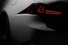 Ljus lampa av den moderna nya vita bilen Arkivbild