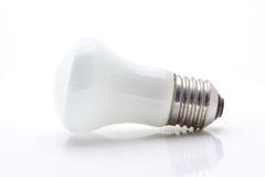 Ljus lampa på vit Arkivfoto