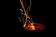 Ljus ljus slinga från brand Arkivfoto