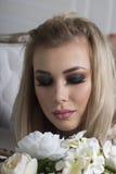 Ljus mörk makeup på en flicka Arkivfoton