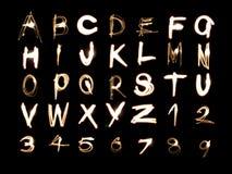 ljus nummermålning för alfabet Fotografering för Bildbyråer