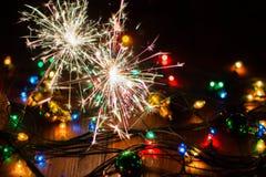 Ljus och leksaker 12 för ` s för nytt år Arkivbilder