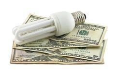 Ljus och pengar Fotografering för Bildbyråer