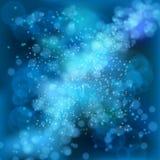 Ljus på blå bakgrundsbokeheffekt. Arkivfoton