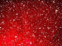 Ljus röd abstrakt julbakgrund med fallande snö fotografering för bildbyråer
