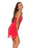 Ljus röd klänning Arkivfoto