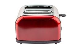 Ljus röd skinande retro brödrost som isoleras på vit Arkivfoto