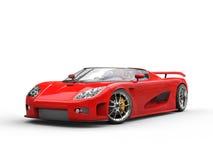 Ljus röd sportbil på vit bakgrund Royaltyfri Foto