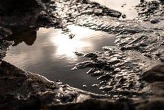 Ljus reflexion för sol på vattenyttersida Royaltyfri Bild