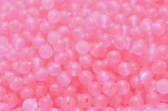 Ljus - rosa färgpärlor Arkivfoton